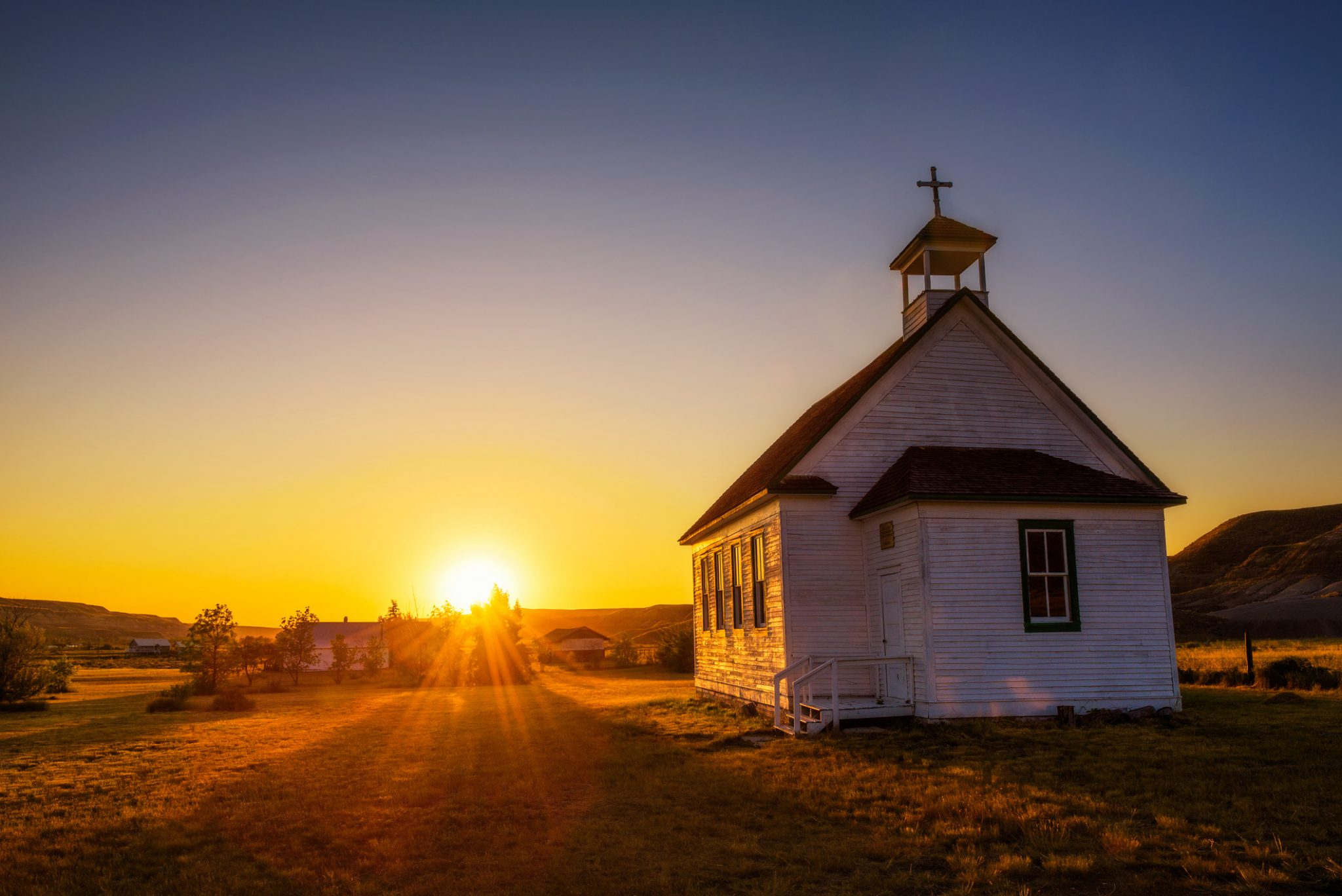 Summer Sunset Over The Old Wooden Pioneer Church In The Ghost Town Of Dorothy In Alberta, Canada Representing