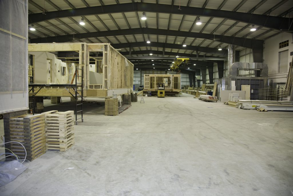 Manufacturing modular homes representing the benefits of modular construction