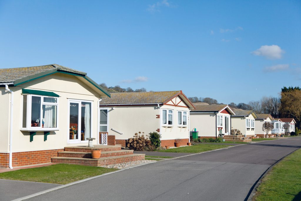 Modular buildings - A row of residential mobile park homes on a caravan park in South East England. Generally this type of caravan park estate is for home owners over the age of fifty years.