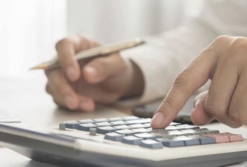 man-calculating-financing-for-modular-building
