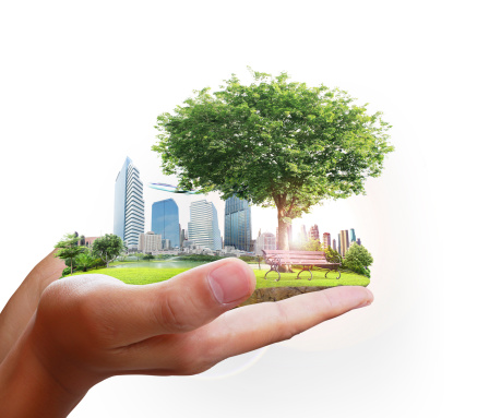human hand holding city - Modular Construction Is Eco-Friendly