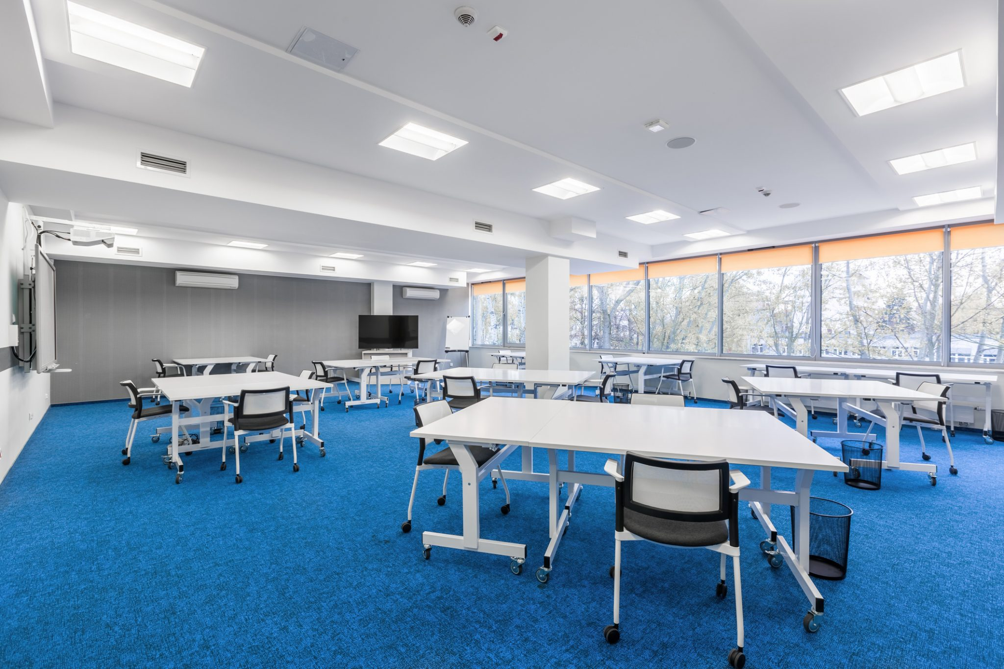 Modular Classroom Considerations - Blue Carpet, White Chairs And Desks